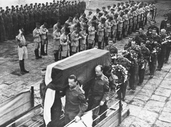 Sikorski's body being carried onto a ship at the Gibraltar Naval Base after his funeral